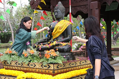 Songkran, traditional blessing and buddha statue cleansing