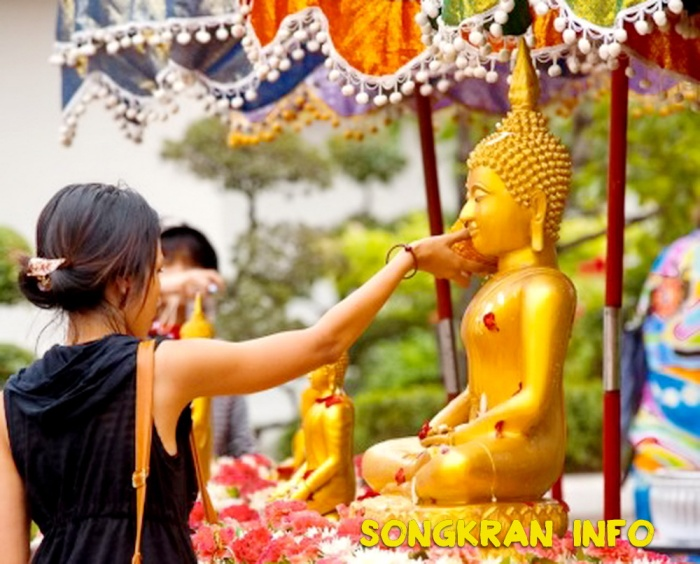 songkran-bathing-buddha-thai-woman-washing-statue-tradition-new-year-new-year-mg-buddhist-new-year