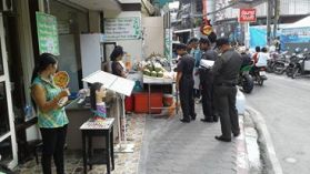 Clean up on the streets of Samui, removing seating, shop displays and temporary work areas.